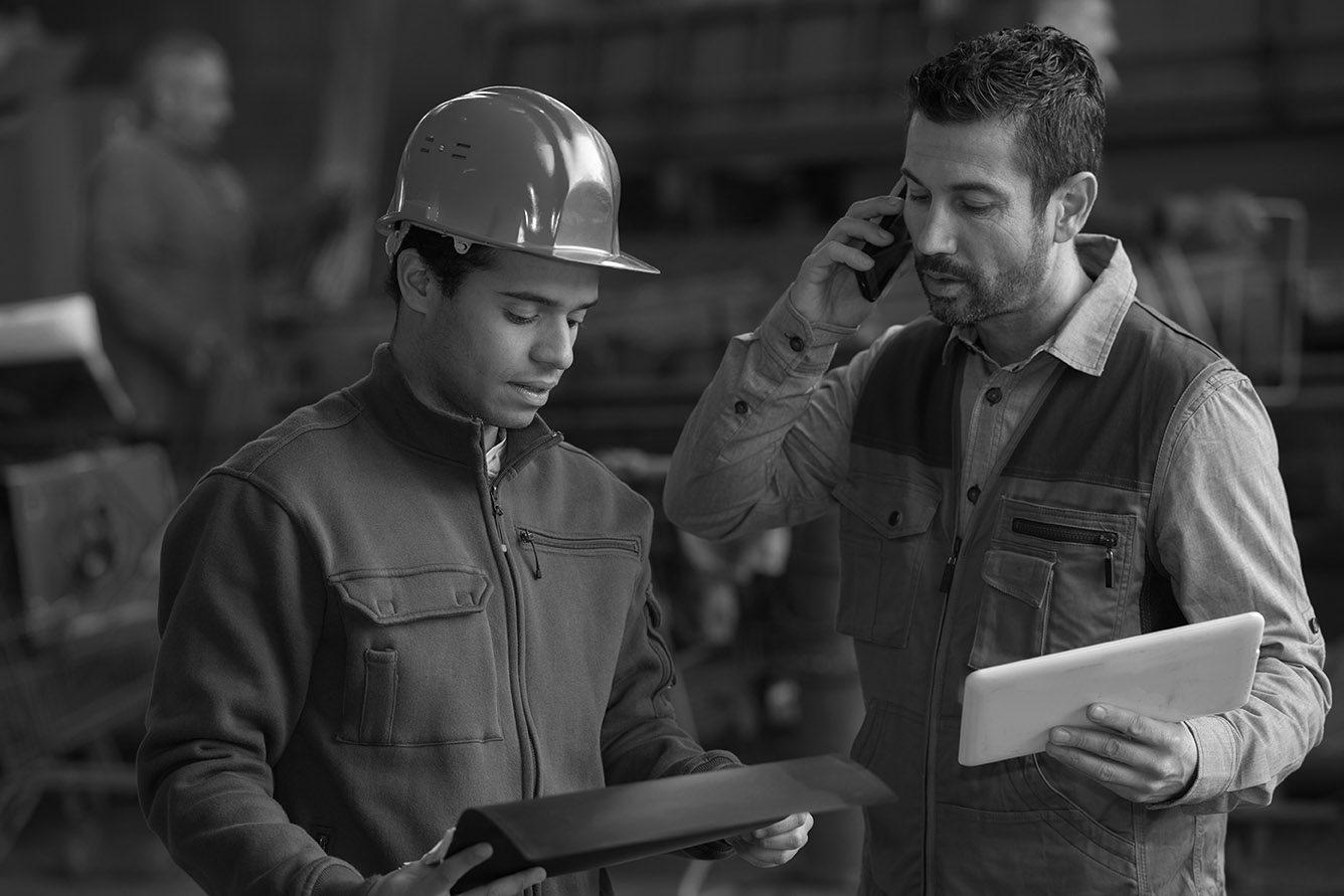 sawmill equipment operators checking status of sawmill equipment